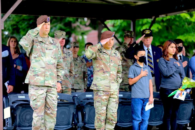 The Security Force Assistance Command's Commanding General, Maj. Gen. Scott Jackson, salutes the U.S. flag alongside the new 5th Security Force Assistance Brigade Commander, Col. Jonathan Chung, at the 5th SFAB's Assumption of Command ceremony, June 30, 2021 at Joint Base Lewis McChord, Washington.