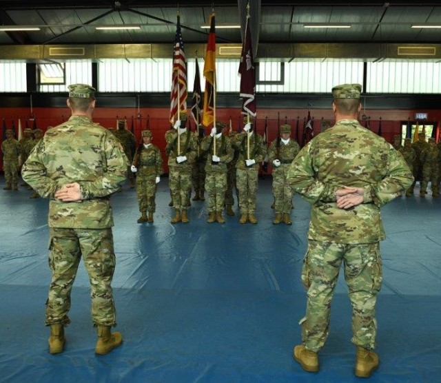 Public Health Command Europe's outgoing commander, Col. Brian Spangler, and incoming commander, Col. Kenneth Spicer, standing in front of the formation.