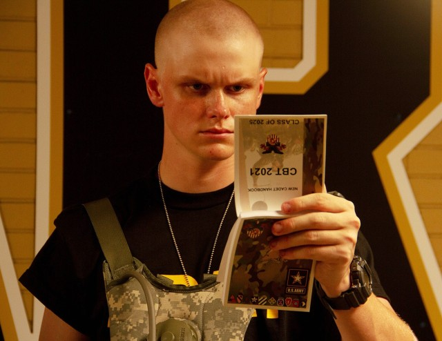 A new cadet reads the New Cadet Handbook during Reception Day at West Point Monday. During the six weeks of Cadet Basic Training, new cadets will be physically and mentally tested as they learn basic combat and leadership skills ahead of the academic year.