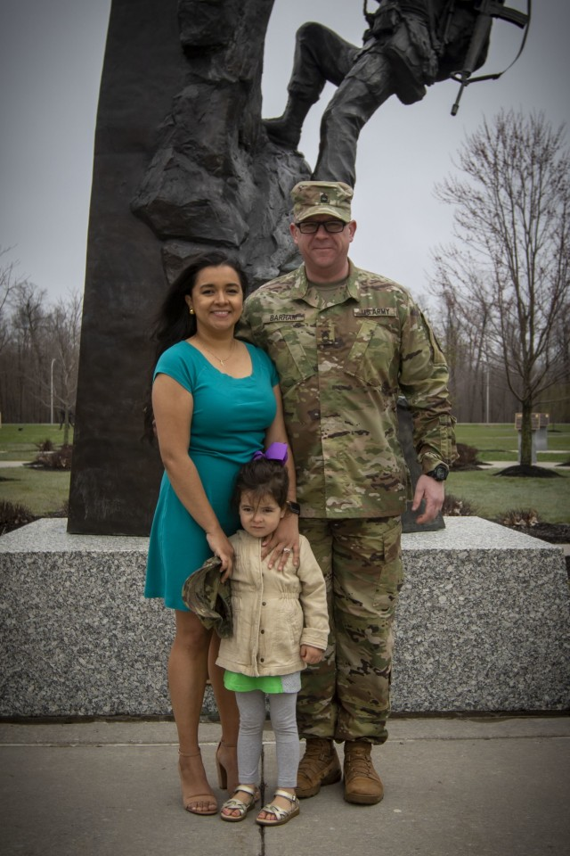Sgt. 1st Class Seth Barham with his wife Ana and daughter Reagan pose for a photo at Memorial Park during his promotion ceremony last year at Fort Drum. The Barham family has since added a new member to their Army family when Ana delivered her son Jack while they were returning home from Syracuse on May 19. (10th Mountain Division PAO photo)