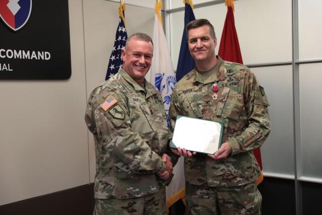 Army Materiel Command Chief of Staff Maj. Gen. Bob Harter presents AMC Command Surgeon Col. Matt Hoefer with the Legion of Merit. (U.S. Army photo by Megan Gully)