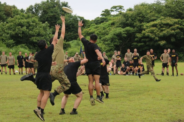 Soldiers assigned to 1st Battalion, 28th Infantry Regiment, 3rd Infantry Division, and members of Japan Ground Self-Defense Force jump to catch a Frisbee during an ultimate Frisbee tournament on Aibano Training Area, Japan, July 2, 2021. Soldiers and members of the JGSDF participated in the tournament in a short break from training during exercise Orient Shield. Orient Shield is the largest U.S. Army and JGSDF bilateral field training exercise being executed in various locations throughout Japan to enhance interoperability and test and refine multi-domain and cross-domain operations.