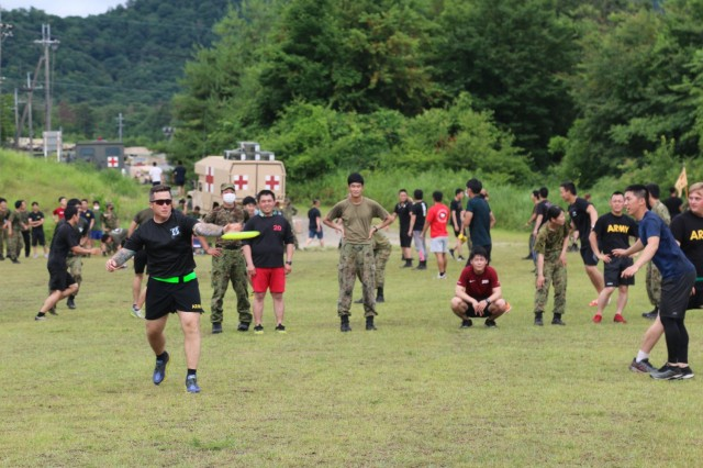 U.S. Army 1st Sgt. William Perry, assigned to 1st Battalion, 28th Infantry Regiment, 3rd Infantry Division, throws a Frisbee while playing in an ultimate Frisbee match against members of the Japan Ground Self-Defense Force on Aibano Training Area, Japan, July 2, 2021. Soldiers and members of the JGSDF participated in the tournament in a short break from training during exercise Orient Shield. Orient Shield is the largest U.S. Army and JGSDF bilateral field training exercise being executed in various locations throughout Japan to enhance interoperability and test and refine multi-domain and cross-domain operations.