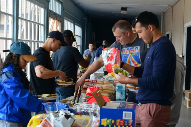 Soldiers and family members of the 229th Military Intelligence Battalion dig into food during the battalion's Cadre Appreciation Day at Presidio of Monterey, Calif., July 1.