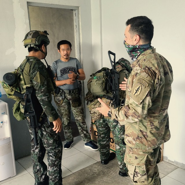 MANILA, Philippines – A Green Beret with 1st Special Forces Group (Airborne), conducts an after action review with the Philippine National Police Special Action Force in Manila, Philippines June 21, 2021 following their annual simulated exercise. The exercise tested the PNPSAF'S ability to conduct crisis response, direct action and hostage rescue missions in complex urban environments. The engagement helped bolster the Philippine Special Action Force as a premier counter-terrorism unit in the Philippines. (U.S. Army courtesy photo) (This Photo has been altered for security purposes)