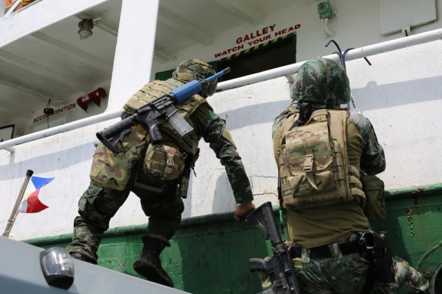 SUBIC BAY, Philippines – Philippine National Police Special Action Force (PNPSAF), carry out a visit, board, search and seizure of a vessel on the Subic Bay during the annual Philippine National Police Special Action Force Simulated Exercise, June 2021. The exercise was observed by Green Berets with 1st Special Forces Group (Airborne) and evaluated the PNPSAF's capability to conduct crisis response direct action and hostage rescue missions in complex environments and continues to foster the PNPSAF as a premier counter-terrorism unit in the Philippines. (U.S. Army courtesy photo)