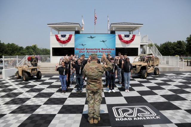 Brig. Gen. Ernest Litynski, Commanding General, 85th U.S. Army Reserve Support Command, swears in future Soldiers, in the Winner's Circle, during the Fourth of July NASCAR Cup Series race at Road America, Elkhart Lake, Wisconsin, July 4, 2021. The U.S. Army recruiting battalion, along with the Appleton Recruiting Company brought recruiters and displays from across their area to meet with citizens, allow them to experience Army technology and evaluate opportunities in military service. Litynski attended the race as the Army's senior leader and swore in 20 future Soldiers at the pre-race ceremonies. (U.S. Army Reserve photo by Anthony L. Taylor)