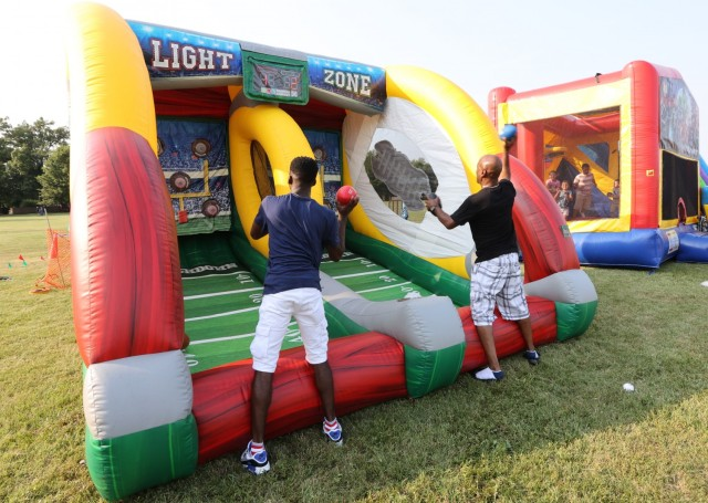 Father and son play games at Fort Knox July 4 Celebration