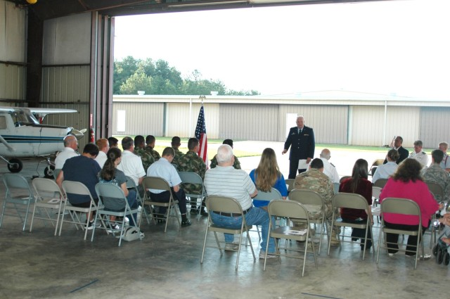 Retired Air Force Lt. Col. C. Ronald Kariker, addresses the audience at the Civil Air Patrol change of command June 22 before the ceremony begins.