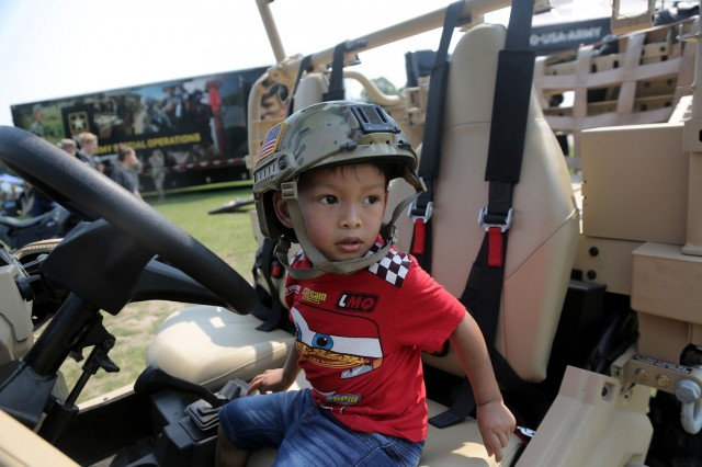 Michael Taylor, 3, pauses for a photo in an Army Polaris MRZR 4 during the Fourth of July NASCAR Cup Series race at Road America, Elkhart Lake, Wisconsin, July 4, 2021. Litynski attended the race as the Army's senior leader and swore in 20 future Soldiers at the pre-race ceremonies. The U.S. Army recruiting battalion, along with the Appleton Recruiting Company brought recruiters and displays from across their area to meet with citizens, allow them to experience Army technology and evaluate opportunities in military service. (U.S. Army Reserve photo by Anthony L. Taylor)