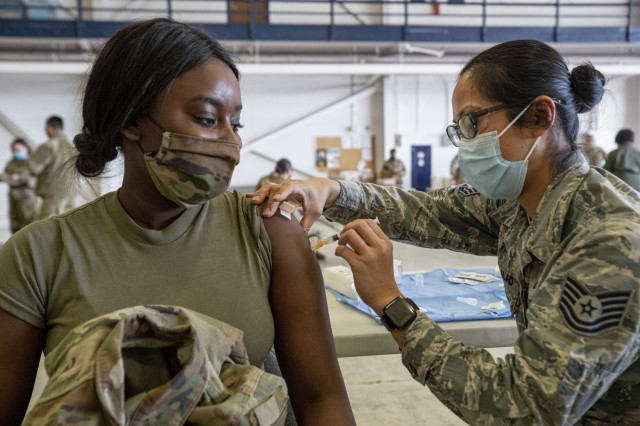 U.S. Army Sgt. Kendra Hallett, left, receives the Covid-19 vaccine from U.S. Air Force Tech. Sgt. Deborah Macalalad 108th Medical Group, New Jersey Air National Guard, on Joint Base McGuire-Dix-Lakehurst, N.J., Feb. 21, 2021. (U.S. Air National Guard photo by Master Sgt. Matt Hecht)