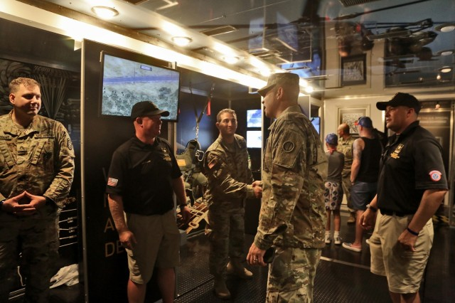 Brig. Gen. Ernest Litynski, center, Commanding General, 85th U.S. Army Reserve Support Command, receives a tour of the U.S. Army Special Operations display trailer from recruiters assigned to the U.S. Army Recruiting Battalion-Milwaukee during the Fourth of July NASCAR Cup Series race at Road America, Elkhart Lake, Wisconsin, July 4, 2021. Litynski attended the race as the Army's senior leader and swore in 20 future Soldiers at the pre-race ceremonies. The U.S. Army recruiting battalion, along with the Appleton Recruiting Company brought recruiters and displays from across their area to meet with citizens, allow them to experience Army technology and evaluate opportunities in military service. (U.S. Army Reserve photo by Anthony L. Taylor)