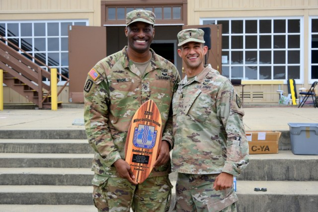 First Lt. Saman Kiani, right, says farewell to Staff Sgt. Willie Wyche during the 229th Military Intelligence Battalion's Cadre Appreciation Day at Presidio of Monterey, Calif., July 1.