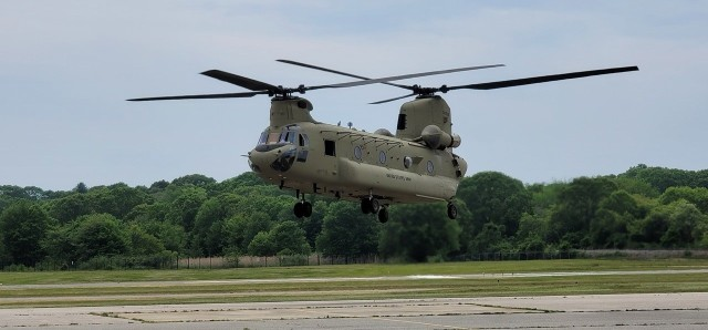 A CH-47 Chinook helicopter hovers for the first time in two years at the Connecticut National Guard's 1109th Theater Aviation Support Maintenance Group in Groton, Conn. June 2, 2021. This helicopter was battle damaged after a hard landing while serving in Iraq and had been sitting in Kuwait since 2018 awaiting repairs.