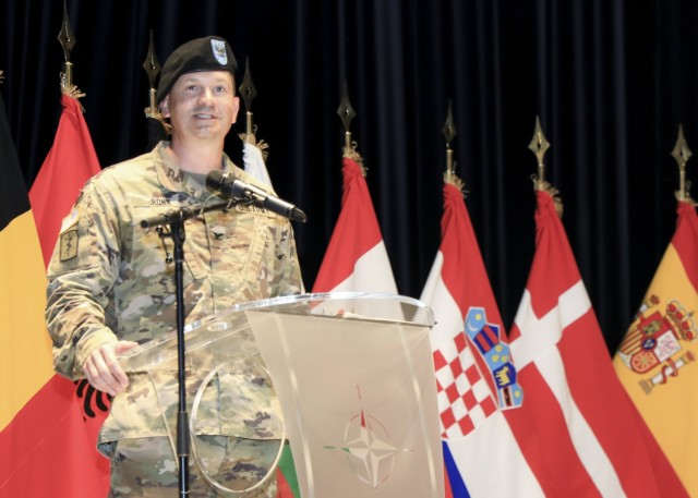 Mons, Belgium – U.S. Army Col. Michael D. Ronn provides remarks during a change of command ceremony where U.S. Army Col. Kathleen G. Spangler relinquished command of Supreme Headquarters Allied Powers Europe (SHAPE) Healthcare Facility and U.S. Army Health Clinic Brussels to Ronn, at SHAPE, Belgium, June 24.