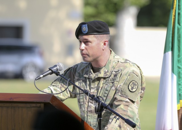 Vicenza, Italy – U.S. Army Lt. Col. Joseph Matthews gives remarks to audiences during U.S. Army Health Clinic Vicenza's change of command ceremony where Matthews relinquished command of USAHC-V to U.S. Army Lt. Col. Carla Schneider at U.S. Army Garrison Italy, June 22.
