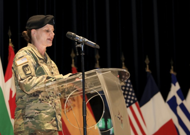Mons, Belgium – U.S. Army Col. Kathleen G. Spangler provides remarks during a change of command ceremony where Spangler relinquished command of Supreme Headquarters Allied Powers Europe (SHAPE) Healthcare Facility and U.S. Army Health Clinic Brussels to U.S. Army Col. Michael D. Ronn, at SHAPE, Belgium, June 24.