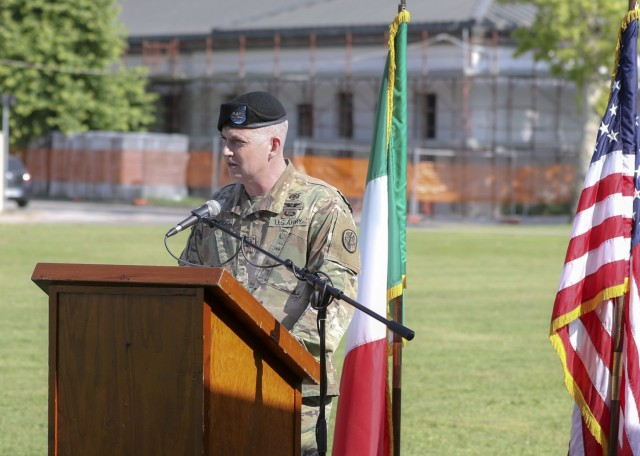 Vicenza, Italy – U.S. Army Col. Andrew Landers, commander, Landstuhl Regional Medical Center, gives remarks to audiences during U.S. Army Health Clinic Vicenza's change of command ceremony where U.S. Army Lt. Col. Joseph Matthews relinquished command of USAHC-V to U.S. Army Lt. Col. Carla Schneider at U.S. Army Garrison Italy, June 22.