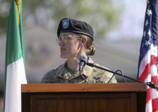 Vicenza, Italy – U.S. Army Lt. Col. Carla Schneider gives remarks to audiences during U.S. Army Health Clinic Vicenza's change of command ceremony where U.S. Army Lt. Col. Joseph Matthews relinquished command of USAHC-V to Schneider at U.S. Army Garrison Italy, June 22.