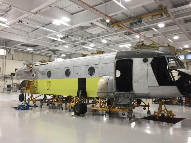 The shell of a CH-47 Chinook helicopter that was battle damaged from a hard landing while serving in Iraq sits in the maintenance bay of the Connecticut National Guard's 1109th Theater Aviation Support Maintenance Group in Groton, Conn. Sept. 3, 2019. The work being done on the aircraft was part of a new initiative from the unit to restore inoperable aircraft and get them back in the Army's operational fleet.