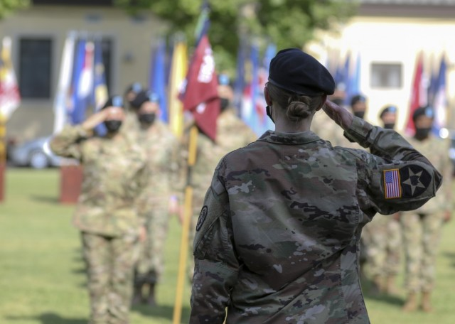 Vicenza, Italy – U.S. Army Lt. Col. Carla Schneider, commander, U.S. Army Health Clinic Vicenza, performs her first salute as the clinic's commander during a change of command ceremony where U.S. Army Lt. Col. Joseph Matthews relinquished command of USAHC-V to Schneider at U.S. Army Garrison Italy, June 22.