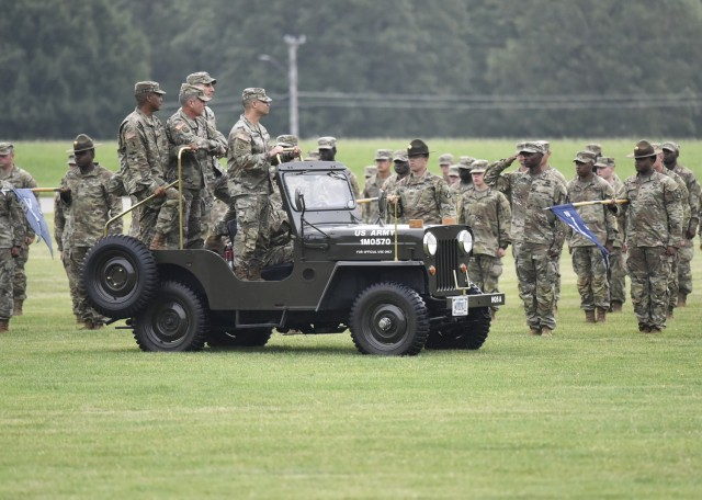 From left in jeep: Cols. Fredrick Parker, Sean Crockett and Adam Hilburgh, along with Lt. Col. Roberto Sanchez, commander of troops for the ceremony, inspect the troops during the 3rd Chemical Brigade change-of-command ceremony July 8 on Gammon Field.