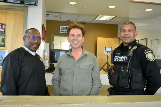 From left, Nathaniel Pleasantbey, Survivor Outreach Services program coordinator, De Amaral, and Lt. Neel Chandra, pose for a photo after De Amaral received his badge at the Visitors Center, PoM, Calif., June 29. Pleasantbey and Chandra were instrumental in securing the badge for De Amaral.