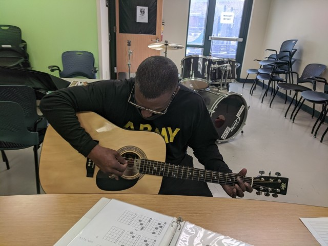 In late January 2021, Sgt. Maj. Gerald Cureton, a Soldier from the Fort Bliss Soldier Recovery Unit, Texas, participated in guitar lessons offered by the SRU's adaptive reconditioning program. (Photo courtesy of Alan Cooksey)