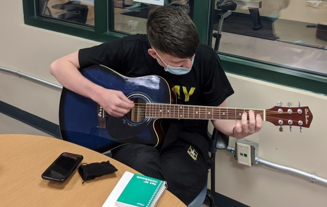 Spc. Skyler Stoker, a Soldier assigned to the Fort Bliss Soldier Recovery Unit, Texas, participated in guitar lessons offered by the SRU's adaptive reconditioning program in late January 2021. (Photo courtesy of Alan Cooksey)