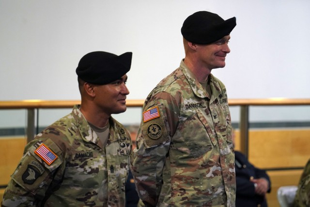 From left to right, Command Sgt. Maj. Sebastian A. Camacho and Col. Christopher R. Danbeck stand at the assumption of responsibility ceremony at the Tower Barracks Physical Fitness Center,  July 9, 2021. (U.S. Army photo by Andreas Kreauzer / USAG Bavaria Public Affairs)