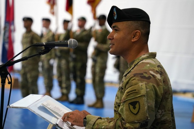 Command Sgt. Maj. Sebastian A. Camacho took the podium during his assumption of responsibility ceremony at the Tower Barracks Physical Fitness Gym, July 9, 2021. (U.S. Army photo by Andreas Kreauzer / USAG Bavaria Public Affairs)
