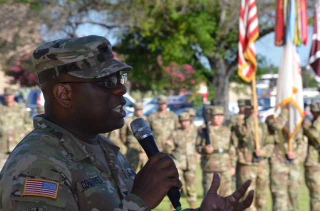 Fort Hood, Texas – Col. Paul Colthirst, commander, U.S. Army Fort Hood Dental Health Activity addresses Soldiers and the audience during a change of command ceremony in which he to command from outgoing Col. Stefan Olpinski on Hildner Field July 1.