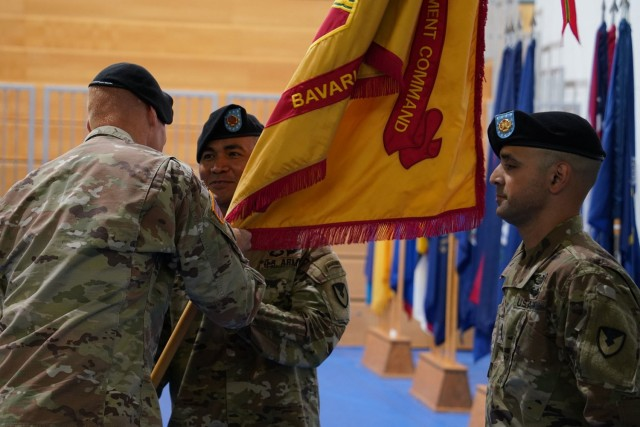 Command Sgt. Maj. Camacho assumed his duties as the senior enlisted leader by receiving the command's colors from U.S. Army Garrison Bavaria Commander Col. Christopher Danbeck, July 9, 2021. (U.S. Army photo by Andreas Kreauzer / USAG Bavaria Public Affairs)