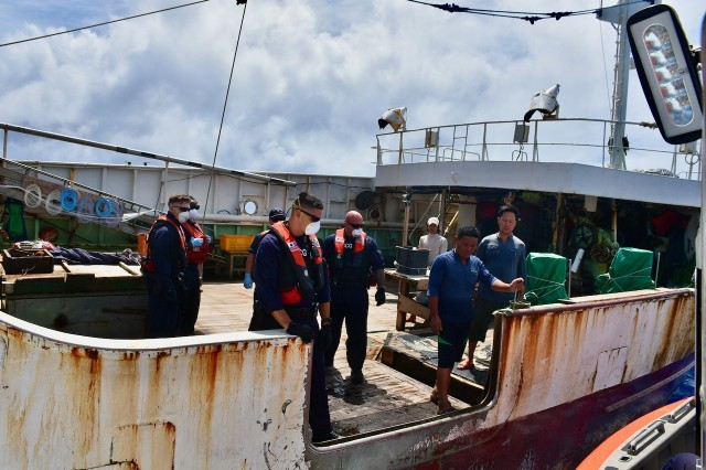 The crew of the Coast Guard Cutter Midgett (WMSL 757) boards a fishing vessel to conduct a law enforcement boarding to ensure compliance with international fisheries regulations and counter illegal, unregulated, and unreported (IUU) fishing in the Pacific Ocean, April 27, 2020. Midgett's crew protected U.S. fisheries by patrolling the U.S. Exclusive Economic Zone (EEZ) surrounding Johnston Atoll, Kingman Reef, and Palmyra Atoll. This action ensured U.S. presence to assure U.S. sovereignty and resource security in these remote regions. (U.S. Coast Guard photo by USCGC Midgett/Released)