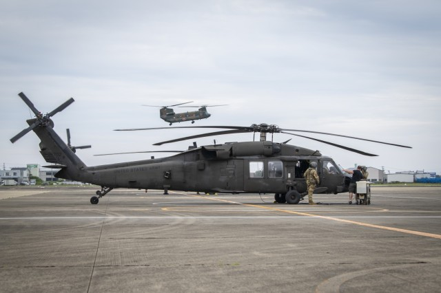 U.S. Army soldiers from the U.S. Army Aviation Battalion - Japan and the 25th Combat Aviation Brigade, land UH-60 Blackhawks at Japanese Ground Self-Defense Force (JGSDF) Camp Akeno, June 28, 2021. The aircraft landed as part of Orient Shield 21-2 in order to aid ground operations across Japan while strengthening existing bonds and collaboration, the regular aerial exercises will also provide both forces the opportunity to exchange new tactics. Orient Shield is the largest U.S. Army and JGSDF bilateral field training exercise being executed in various locations throughout Japan to enhance interoperability. (U.S. Marine Corps photo by Lance Cpl John Hall)