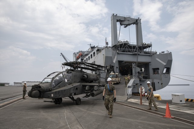 U.S. Army soldiers with U.S. Army Transportation Battalion direct an AH-64 Apache aboard Marine Corps Air Station Iwakuni, Japan, June 24, 2021, as part of ORIENT SHIELD 21-2 (OS 21-2). OS 21-2 is the largest annual bilateral field training exercise in Japan between the U.S. Army and the Japan Ground Self-Defense Force (JGSDF), with approximately 1,400 U.S personnel and 1,600 JGSDF personnel in participation. With both its air and sea facilities, MCAS Iwakuni is uniquely positioned to support the dynamic employment of forces across the Indo-Pacific area of operations. (U.S. Marine Corps photo by Cpl. Mitchell Austin)