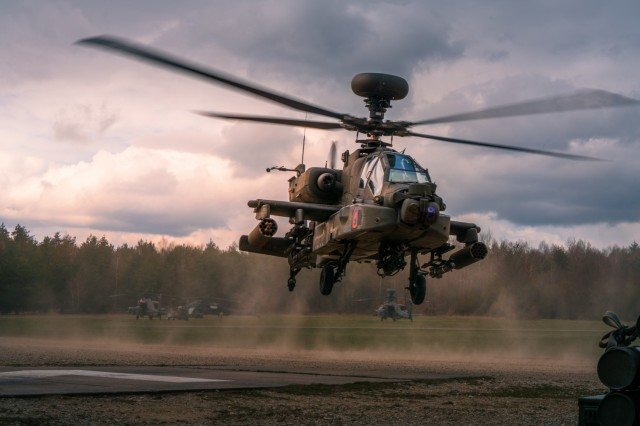 An AH-64 Apache of the 12th Combat Aviation Brigade, Wings of Victory, launches from the forward area rearming and refueling point to begin single-ship aerial gunnery tables during the 1st Battalion, 3rd Aviation Regiment's preparation for DEFENDER-Europe 21 at Grafenwöhr Training Area on April 14, 2021. (U.S. Army photo by Maj. Robert Fellingham)