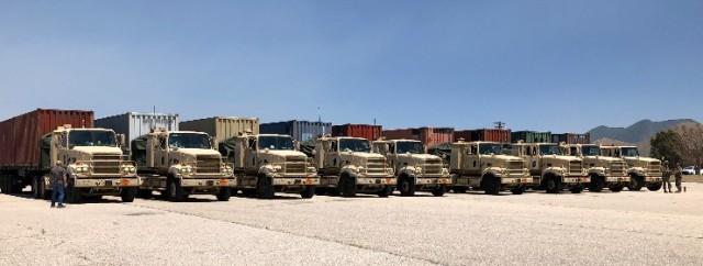 Row of army trucks.