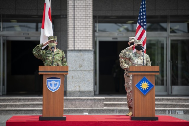 Maj. Gen. Laura Yeager, 40th Infantry Division Commander; Lt. Gen. Shin Nozawa, JGSDF Middle Army Commander; and Mr. Minoru Kihara, Special Advisor to the Prime Minister for National Security Affairs, delivered remarks to members of the Japan Ground Self-Defense Force and U.S. Army soldiers during the Orient Shield 21-2 opening ceremony at Camp Itami, June 24, 2021. Each detailed a shared commitment to peace and stability in the Indo-Pacific, and emphasized the exercise's importance in enhancing and refining interoperability to support bilateral capabilities in the Indo-Pacific region. Orient Shield 21-2 is the largest U.S. Army and Japan Ground Self-Defense Force bilateral field training exercise being executed in various locations throughout Japan to enhance interoperability and test and refine multi-domain and cross-domain operations. (U.S. Marine Corps photo by Lance Cpl John Hall)