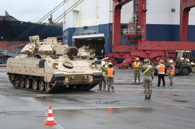 Logisticians and transporters from the 598th Transportation Brigade, Surface Deployment and Distribution Command and the 21st Theater Sustainment Command began offloading more than 1000 equipment items at the port in Gdansk, Poland, July 8, 2021. After receiving the equipment off the vessel, the 16th Sustainment Brigade, 21st TSC is responsible for its onward movement. This ensures the right equipment items arrive at the right forward locations. (U.S. Army photo by Spc. Katelyn Myers)