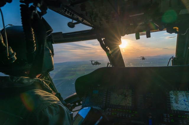 U.S. Army Chief Warrant Officer 3 Geoffrey Kinney, a UH-60 pilot assigned to the 12th Combat Aviation Brigade, Wings of Victory, flies his Black Hawk in formation en route back to base after maritime operations crew certification flights over the Black Sea coast of Bulgaria on May 5, 2021, during Exercise Swift Response 21, part of DEFENDER-Europe 21. (U.S. Army photo by Staff Sgt. Christopher Stewart)  DEFENDER-Europe 21 is a large-scale U.S. Army-led exercise designed to build readiness and interoperability between the U.S., NATO allies and partner militaries. This year, more than 30,000 multinational forces from 26 nations will conduct nearly simultaneous operations across more than 30 training areas in 14 countries from the Baltics to the strategically important Balkans and Black Sea Region. Follow the latest news and information about DEFENDER-Europe 21, visit www.EuropeAfrica.army.mil/DefenderEurope.