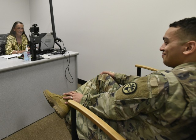 Melinda Alexander, a human resources assistant at Fort Leonard Wood's Defense Enrollment Eligibility Reporting System, or DEERS, ID card office, helps a customer July 13. Office staff have worked this year to improve the experiences of their customers.