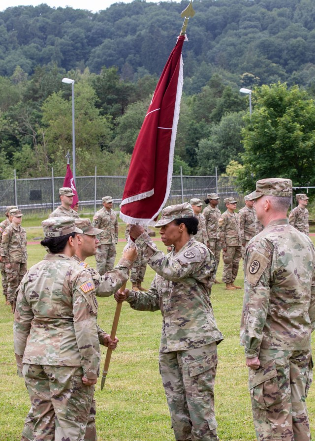 U.S. Army Lt. Col. Christina Buchner  receives the unit colors from U.S. Army Command Sgt. Maj. John Contreras,  command sergeant major, Troop Command, Landstuhl Regional Medical Center, during a change of command ceremony where Buchner relinquished command of Troop Command, LRMC, to U.S. Army Lt. Col. Casey Wilson, at LRMC, July 1.