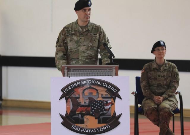 U.S. Army Maj. Stephen Harmon makes remarks during U.S. Army Health Clinic Kaiserslautern's change of command ceremony where U.S. Army Maj. Shara Fisher relinquished command to U.S. Army Maj. Stephen Harmon at Kleber Kaserne, June 30.