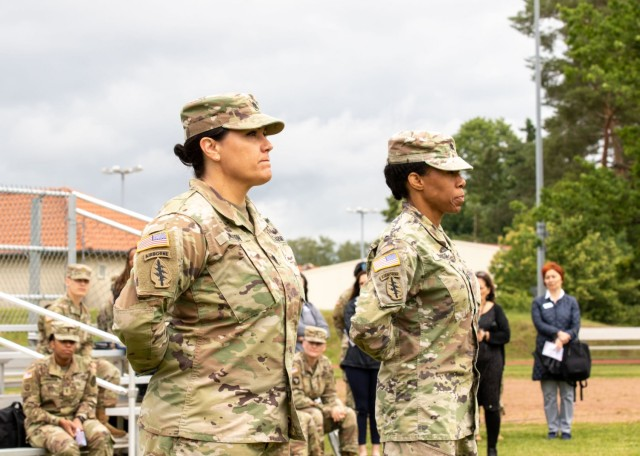 U.S. Army Lt. Cols. Casey Wilson (left) and Christina Buchner, stand at parade rest during a change of command ceremony where Buchner relinquished command of Troop Command, Landstuhl Regional Medical Center, to Wilson, at LRMC, July 1.