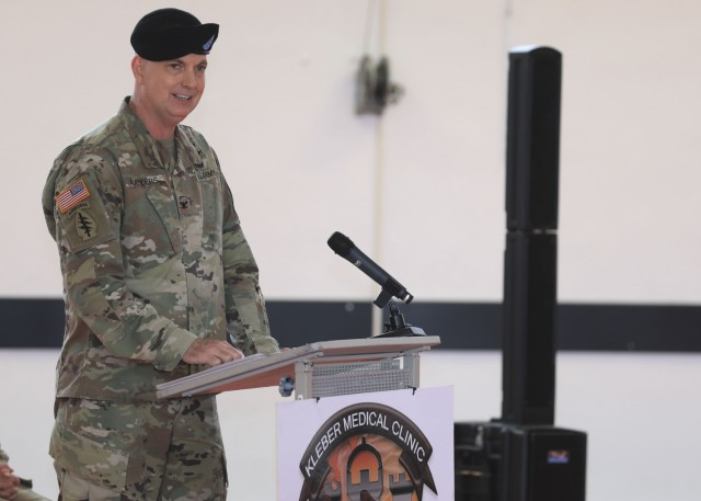U.S. Army Col. Andrew Landers, commander, Landstuhl Regional Medical Center, provides remarks during a change of command ceremony where U.S. Army Maj. Shara Fisher relinquished command to U.S. Army Maj. Stephen Harmon at Kleber Kaserne, June 30.