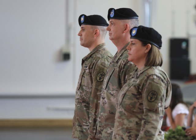(From left) U.S. Army Maj. Stephen Harmon, U.S. Army Col. Andrew Landers, commander, Landstuhl Regional Medical Center, and  U.S. Army Maj. Shara Fisher, stand side by side during U.S. Army Health Clinic Kaiserslautern's change of command ceremony where Fisher relinquished command to Harmon at Kleber Kaserne, June 30.