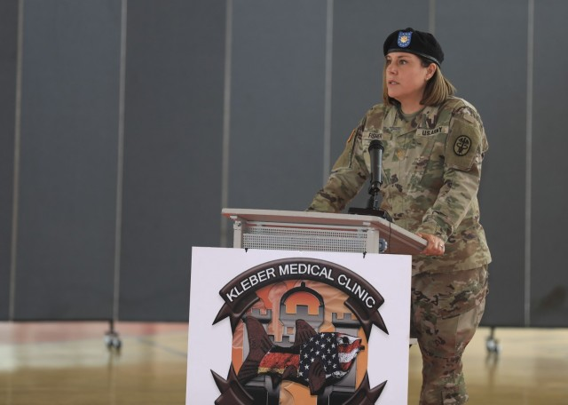 U.S. Army Maj. Shara Fisher gives remarks during U.S. Army Health Clinic Kaiserslautern change of command ceremony where Fisher relinquished command to U.S. Army Maj. Stephen Harmon at Kleber Kaserne, June 30.