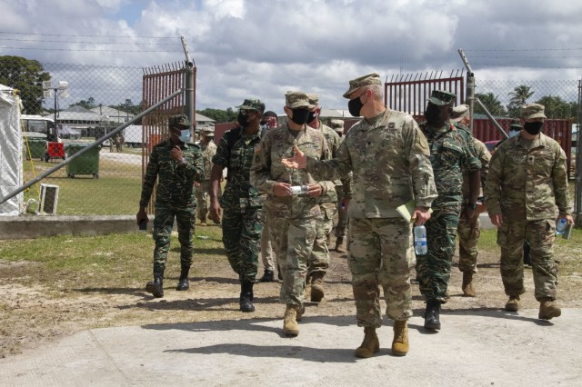 Maj. Gen. Rafael A. Ribas, deputy commander for mobilization and reserve affairs, U.S. Southern Command, receives a tour from Lt. Col. Timothy Starke, commander of 75th Troop Command, Kentucky National Guard during Tradewinds 21 at Camp Stephenson, Guyana, June 24, 2021. Tradewinds 21 is a U.S. Southern Command (SOUTHCOM) sponsored Caribbean security-focused exercise in the ground, air, sea, and cyber domains; working with partner nations to conduct joint, combined, and interagency training, focused on increasing regional cooperation and stability.