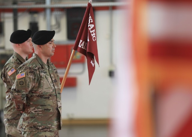 Soldiers stand at parade rest during the U.S. Army Health Clinic Kaiserslautern change of command ceremony where U.S. Army Maj. Shara Fisher relinquished command to U.S. Army Maj. Stephen Harmon at Kleber Kaserne, June 30.